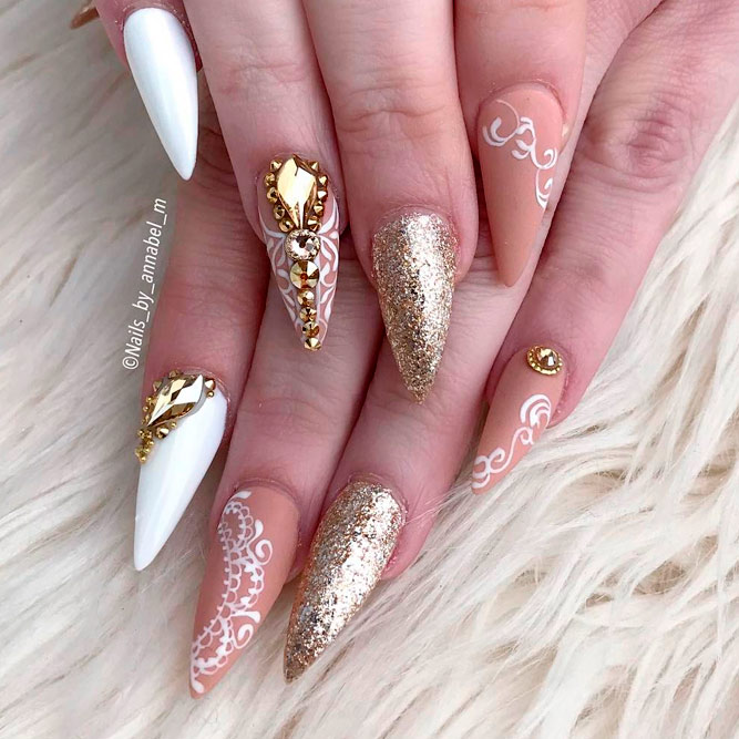 Stiletto Nails with Gold Accents picture 1