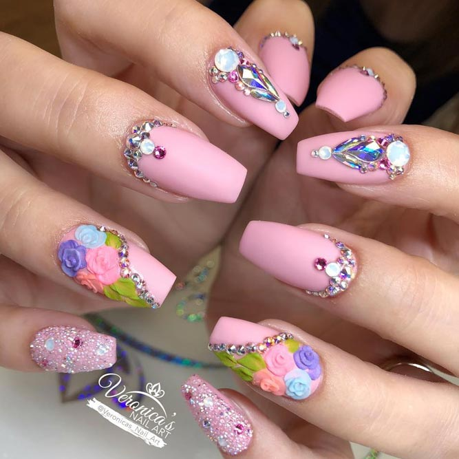 Long Pink Nails Dressed Up With Flowers And Rhinestones #coffinnails #pinknails #flowernails #rhinestonesnails