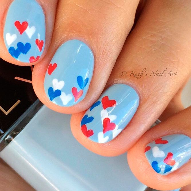 Beautiful Nails With Heart Accent On Sky Blue Polish