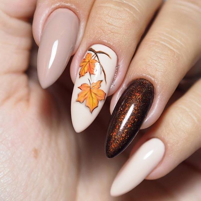 Taupe Nails With Dark Glitter and Fallen Leaves #nudenails #pointednails #longnails #stilettonails