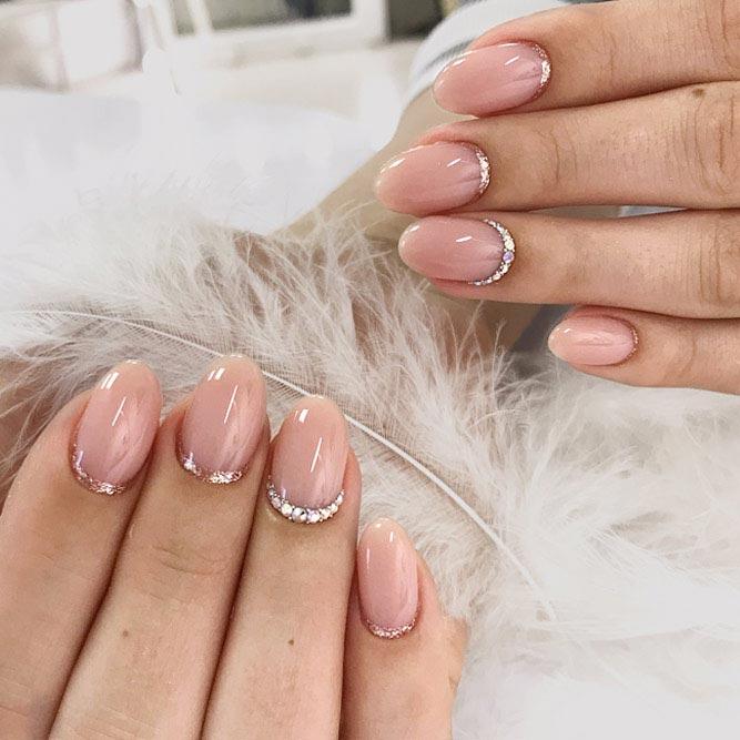 Gorgeous Sparkly Crescent Manicure #nudenails #ovalnails #crescentnails #rhinestonesnails