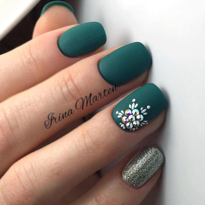 Matte Green Nails With Floral Pattern And Glitter Accent