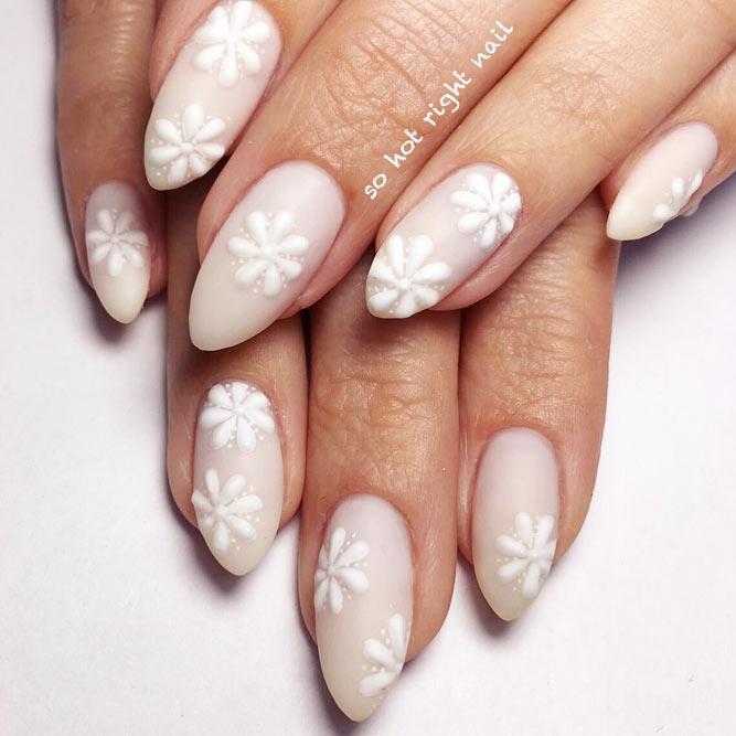 Tender White Daisies On Nude Matte Color #nudenails #floralnails #daisiesnails #almondnails