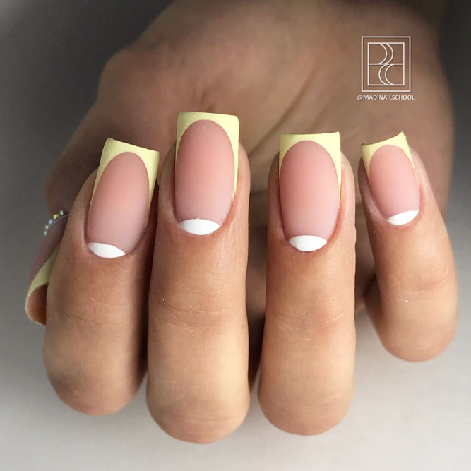Soft Yellow French Tips For A Flirty Look #yellownails #frenchnails #frenchtips #halfmoonnails