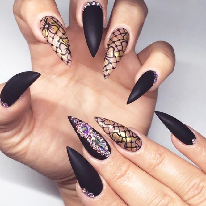 Black Stiletto Nail Designs With Gorgeous Rhinestones And Laced Accent #lacenails #pointednails #rhinestonesnails #mattenails