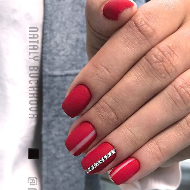 Classy Red Nails With Elegant Accents