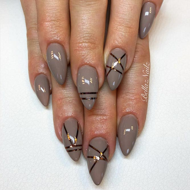 Taupe Nails Decorated With Metallic Stripes #longtnails #almondnails #stripenails