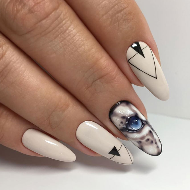 Beige Colored Nails With Geometrical And Cat Stickers Designs