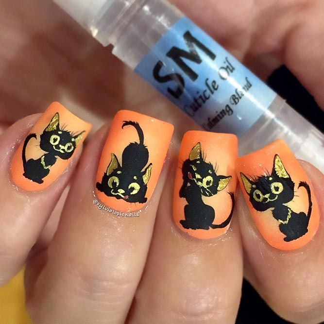 A Bright Orange Color With Black Cats