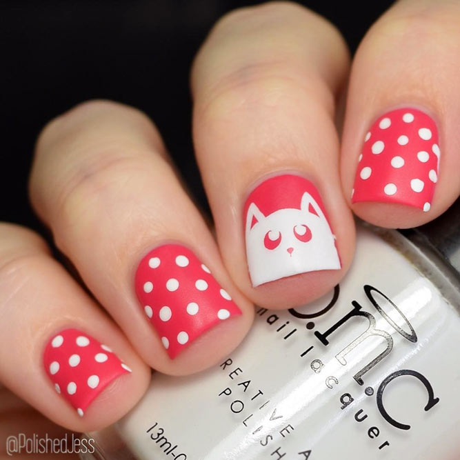 Pink Colored Nails With Polka Dots And A Cat Muzzle Design