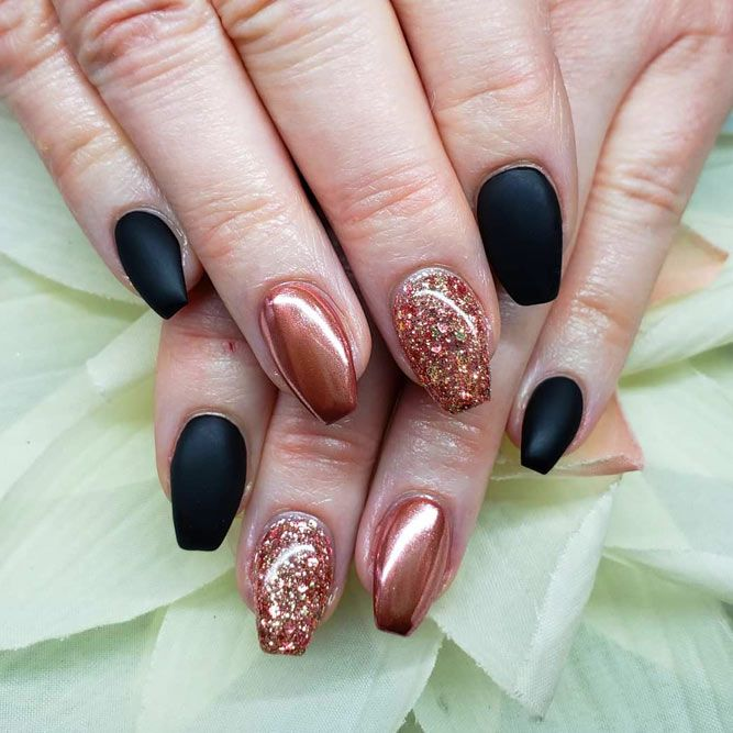 Bold Combination Of Black And Gold Glitter Coffin Nails